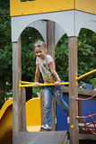 Girl on playground. A cute little caucasian girl child having great fun on the playground in outdoors Stock Photos
