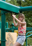 Girl on Playground Equipment Royalty Free Stock Photos