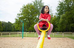 Girl on playground. Horizontal view of girl on a playground Royalty Free Stock Photo