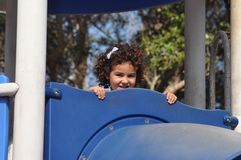 Girl in a playground Stock Photos