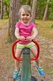 Girl on the playground Stock Photos