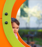 Girl on the playground playing hide and seek Royalty Free Stock Photos