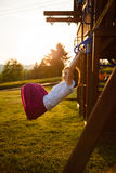Girl in a playground. Girl at the rings in a playground Royalty Free Stock Photos