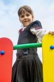 Girl on the playground's bridge Royalty Free Stock Photos