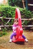 Girl on Playground toy stock image