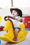 Girl on Playground toy stock photos