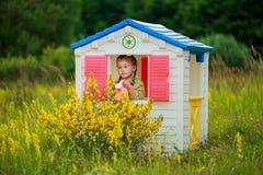 Girl in playhouse Royalty Free Stock Photos