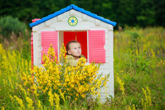 Girl in playhouse Royalty Free Stock Photo