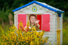 Girl in playhouse Royalty Free Stock Photography