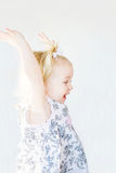 Girl Playing. Cute Little Girl Playing With Arms Up Stock Photos