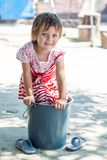 Girl playing. With a bucket Stock Photography