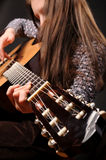 Girl playing acoustic guitar Stock Photo