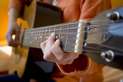 Girl playing the acoustic  guitar Stock Photos