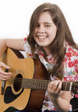 Girl playing acoustic guitar Royalty Free Stock Images