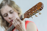 Girl playing acoustic guitar Stock Image