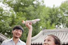 Girl Playing with Airplane Stock Photo