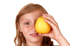 Girl playing with apple. Stock Images