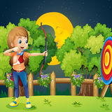 A girl playing archery Royalty Free Stock Image