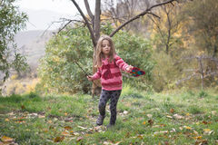 Girl playing in the autumn field Royalty Free Stock Images