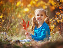 Girl playing in the autumn Stock Photography