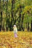Girl playing in autumn park Stock Photos