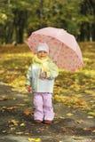 Girl playing in autumn park Stock Photos