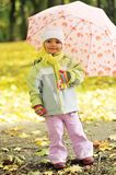 Girl playing in autumn park Royalty Free Stock Photos