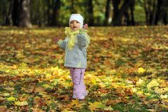 Girl playing in autumn park Stock Photo