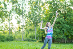 Girl playing badminton. In the park Stock Photos