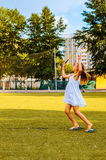 Girl is playing badminton in park. Stock Photo