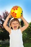 Girl playing with ball Royalty Free Stock Photo