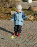 Girl playing with ball Royalty Free Stock Images
