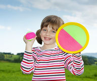 girl playing with a ball Stock Images