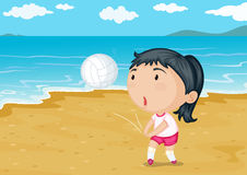 A girl playing ball on a beach Royalty Free Stock Photos