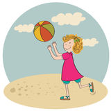 Girl playing ball on the beach Royalty Free Stock Image