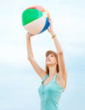 Girl playing ball on the beach Stock Photography