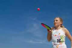 Girl playing a ball game Royalty Free Stock Photo