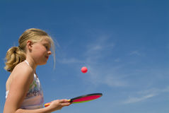 Girl playing a ball game Stock Image