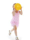 Girl playing with a ball. Stock Photo