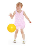 Girl playing with a ball. Stock Photography