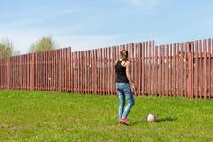 Girl playing ball Stock Image