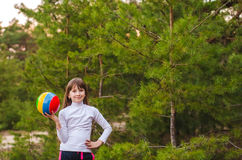 Girl playing with a ball Royalty Free Stock Photography
