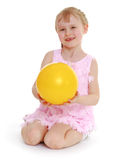 Girl playing with a ball. Royalty Free Stock Photography