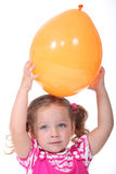 Girl playing with a balloon Royalty Free Stock Images