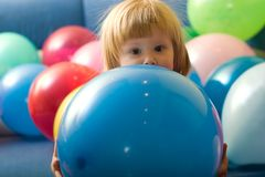 Girl playing with balloons Royalty Free Stock Photo