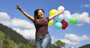 Girl playing with balloons. Girl playing with color balloons outdoor Stock Image