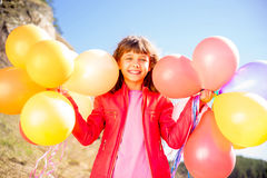 Girl playing with balloons Stock Image