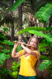 Girl playing the bamboo flute Stock Photos