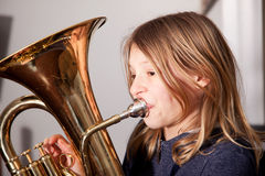 Girl playing baritone Stock Photos