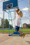 Girl playing basketball outside. Young blond girl is playing basketball outside Stock Photo